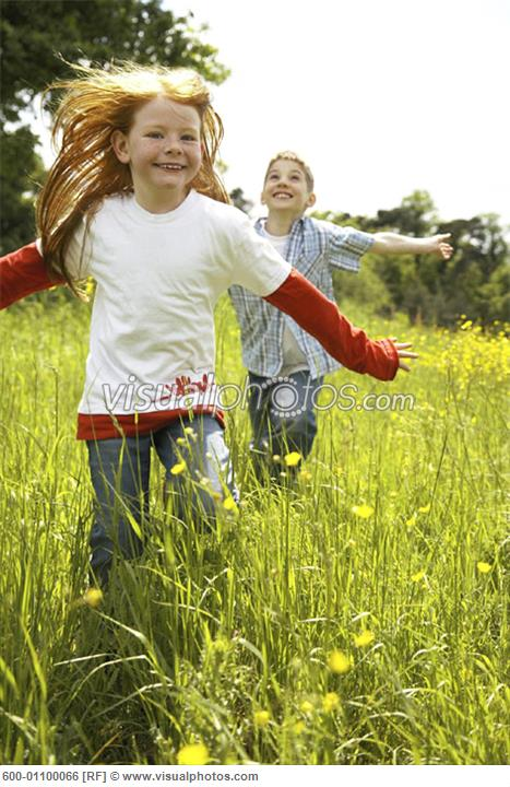 Girl and Boy Running in Field